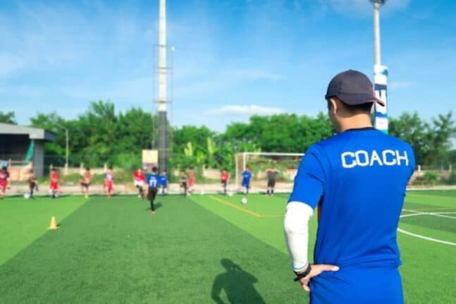 Soccer coach watching soccer tryouts